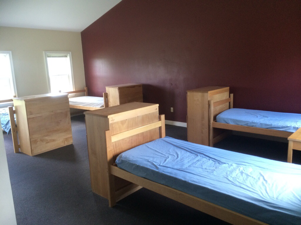 Four twin beds with dressers
